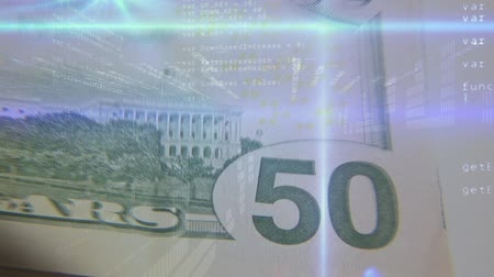 us banknotes : Digital animation of program codes moving in the screen with a background of fifty dollar paper bills Stock Footage