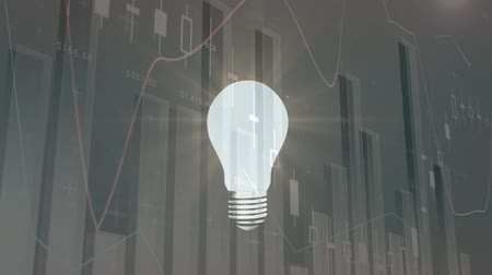 와트 : Digitally generated light bulb turning on and a grey background with different graphs