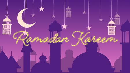 hilâl : Digitally generated animation of a gold glitter Ramadan Kareem greeting with a purple background of mosque silhouettes and lanterns hanging with the stars and crescent moon in white