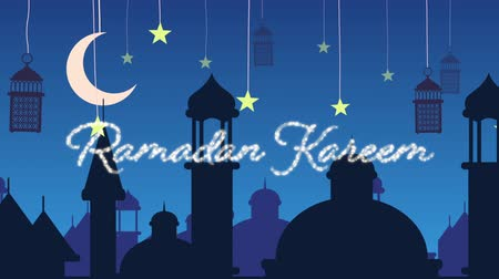 hilâl : Digitally generated animation of a silver glitter Ramadan Kareem greeting with a blue background of mosque silhouettes and black lanterns hanging with yellow stars and crescent moon in white