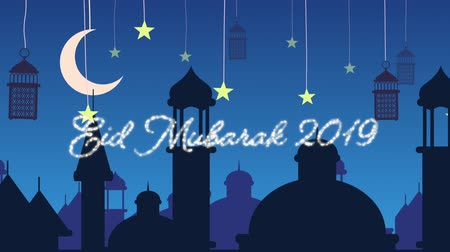 arabeska : Digitally generated animation of a silver glitter Eid Mubarak greeting for 2019 with a blue  background of mosque silhouettes and black lanterns hanging with yellow stars and crescent moon in white Dostupné videozáznamy