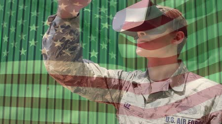 spangled : Digital composite of a US soldier wearing a virtual reality headset with an American flag waving in the foreground