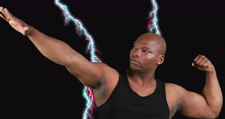 хмурый : Close up of an African-american male bodybuilder flexing his biceps with digital lightning striking on a black background 4k