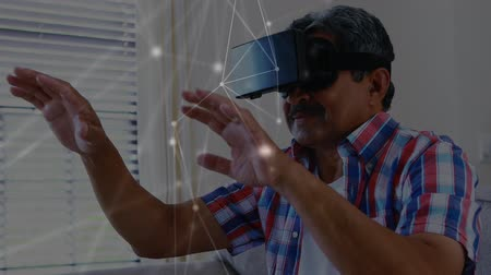 развлекать : Digital composite of a man wearing a virtual reality headset moving his arms in the air with lines and dots running in the foreground Стоковые видеозаписи