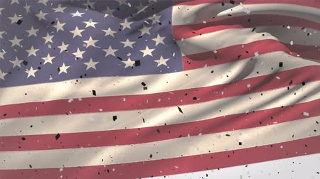 usa independence day : Digital animation of an American flag waving against the wind while confetti falls down Stock Footage