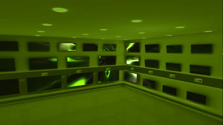 развлекать : Digital animation of displayed monitors showing green light flashes in a green room