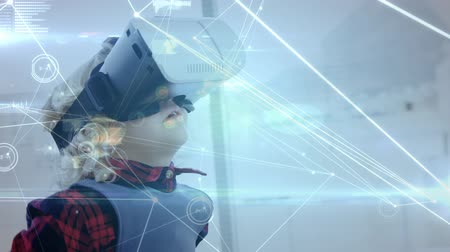 amusing : Digital composite of a little boy waving his hands while wearing a virtual reality headset with connected lines and dots in the foreground
