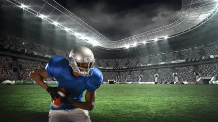 agacharse : Digital animation of an African-american football player setting up a throw with a field stadium background