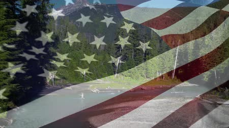 spangled : Digital composite of a river at a national park with an American flag waving in the foreground