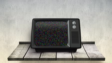развлекать : Digital animation of a television on a wall counter with a blank channel on its screen