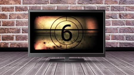 changing channel : Digital animation of a flat screen television with a film countdown on its screen Stock Footage