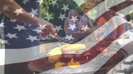 영광 : Digital composite of friends at a barbecue picnic with an American flag waving in the foreground 무비클립