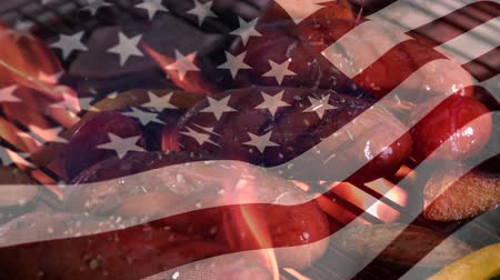 old glory : Digital composite of a sausages grilling and an American flag waving the foreground