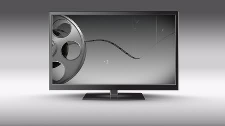 changing channel : Digital animation of a flat screen television with film roll on its screen