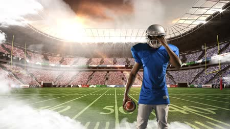 mračící : Digital animation of an African-american football player with a serious expression while standing on a foggy field stadium