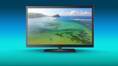 seasons changing : Digital animation of an HD television with a beautiful beach on its screen Stock Footage