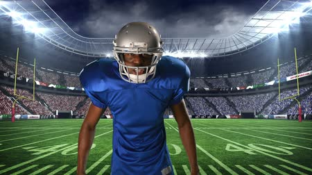 строгий : Digital animation of an African-american football player taunting on a field stadium background
