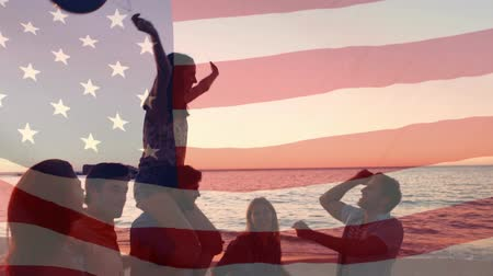 glória : Digital composite of a group of friend carrying a woman with balloons on the beach with an American flag waving in the foreground