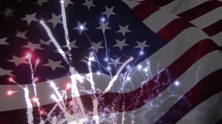 york : Digital composite of fireworks with an American flag waving in the foreground