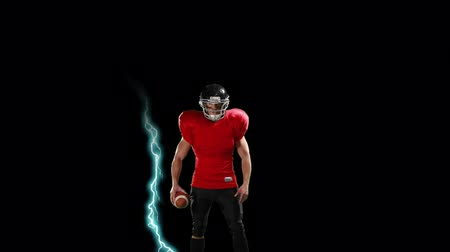 dobrar : Digital animation of an American football athlete with lightning strikes behind him on a black background Stock Footage