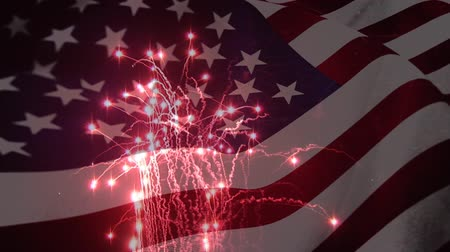 old glory : Digital animation of a fireworks display with an American flag waving in the foreground
