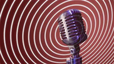 okoun : Digital animation of a microphone with concentric circles moving outwards from the microphone Dostupné videozáznamy