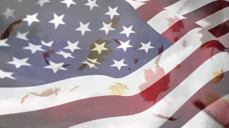 spangled : Digital composite of leaved falling with an American flag waving in the foreground
