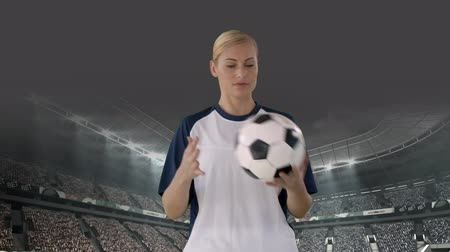 dobrar : Front view of a Caucasian female football player playing with ball at a stadium