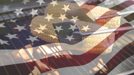 glória : Digital composite of corn grilling with an American flag waving in the foreground