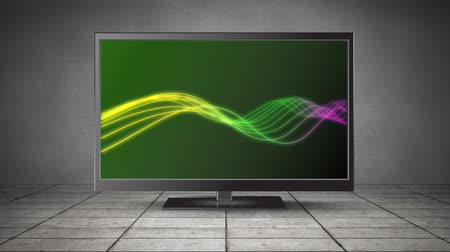 changing channel : Digital animation of a flat screen TV with glowing strings of light on its screen