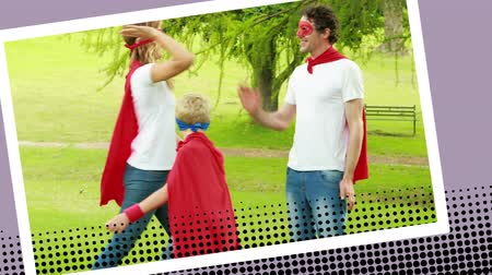 развлекать : Front view of a family with one son wearing superhero costumes while running in the park in a digital photo border effect