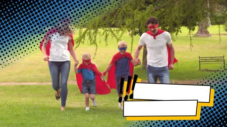 герой : front view of a family with two kids running in the park while wearing superhero costumes with digital dotted border effect