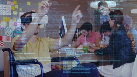 beside : Digital composite of a Caucasian man wearing a virtual reality headset beside his coworkers with program codes running in the foreground Stock Footage
