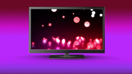 changing channel : Digital animation of a flat screen TV with glowing marbles on its screen Stock Footage