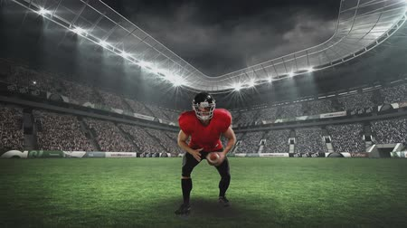duruş : Front view of an American football player pretending to throw the ball on the field Stok Video