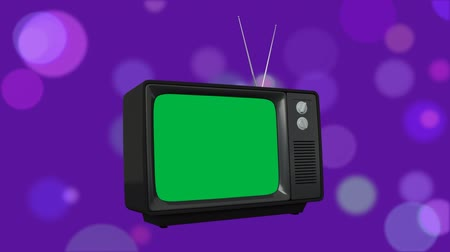 série : Digital animation of a television with a green screen with bokeh lights in the background Vídeos