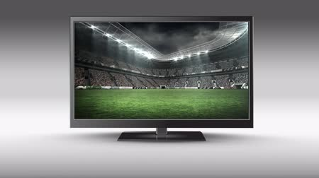changing channel : Digital animation of a flat screen TV with a football stadium on its screen Stock Footage