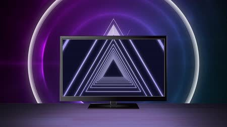tv channel : Digital animation of a television with concentric triangles on its screen and a bright glowing background