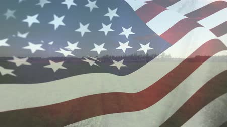 glória : Digital composite of an American flag waving against the wind and an open field in the background Vídeos