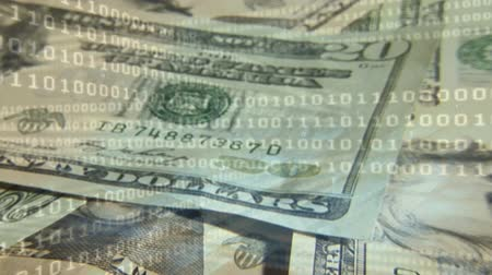banknoty : Digital animation of 20 dollar bills with binary codes in the foreground.