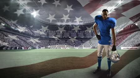 ábrázol : Digital composite of an African-american football athlete limbering up for a game with a background of a stadium and the American flag waving against the wind