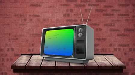 changing channel : Digital animation of a television on top of a wooden table and a brick wall background with a colourful pixel noise on its screen