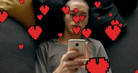 abandonment : Digital composite of a bald Caucasian guy lying in bed texting and digital hearts flying in the foreground. The guy seems to be sad 4k