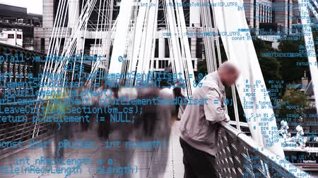 abandonment : Digital composite of an old man leaning on a bridge rail while people pass by with interface codes running in the foreground