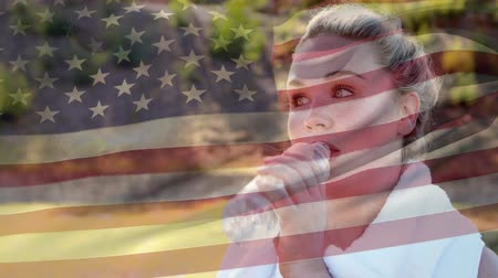 glória : Digital composite of a woman wiping sweat and drinking water with an American flag waving in the foreground
