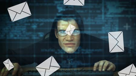 destravar : Digital composite of a suspicious Caucasian man wearing a hoodie working on a computer with email icons and interface codes running in the foreground
