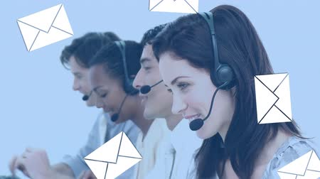 operators : Digital composite of a Caucasian female call centre agent beside her colleagues smiling with email icons flying in the foreground