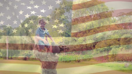 служить : Digital composite of an American soldier and his son running towards each other giving warm hugs with an American flag waving in the foreground