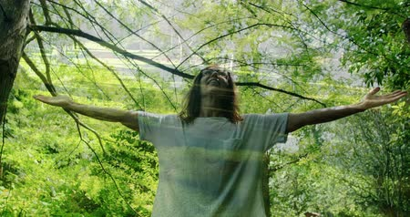 amusing : Digital composite of a Caucasian woman with arms wide open in the forest 4k