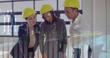 kifinomult : Digital composite of three architects discussing about building plans laid out on a table with graphs and statistics running in the foreground 4k